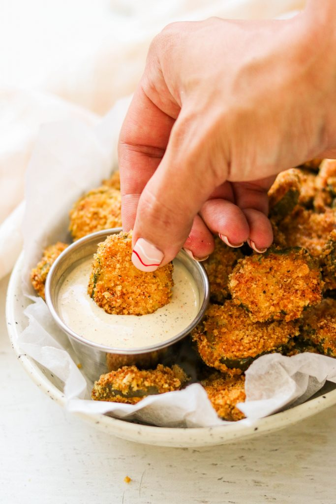 dipping an air fried pickle in ranch