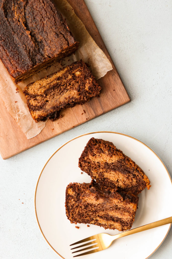 marbled healthy gluten free pumpkin bread, sliced on a plate