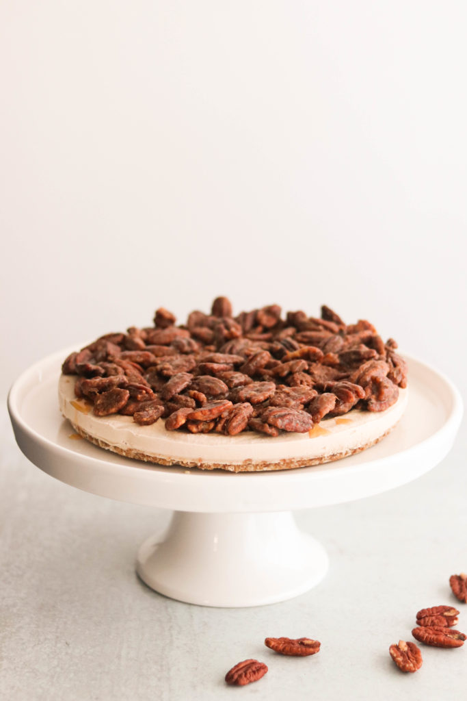 paleo & vegan pecan pie cheesecake on a cake stand