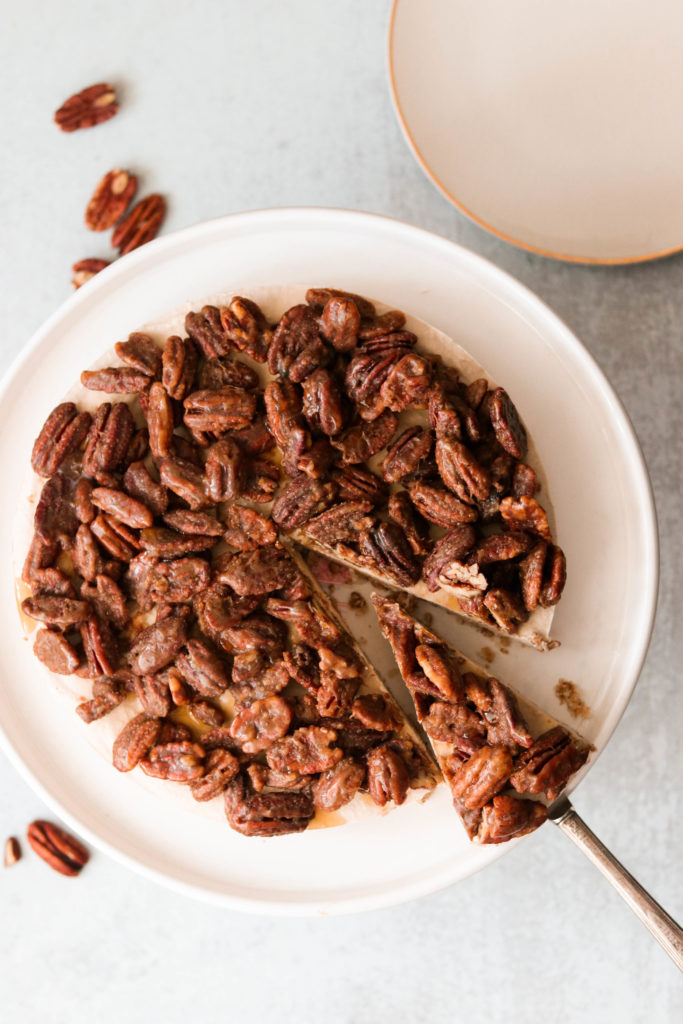 slicing into no bake pecan pie cheesecake