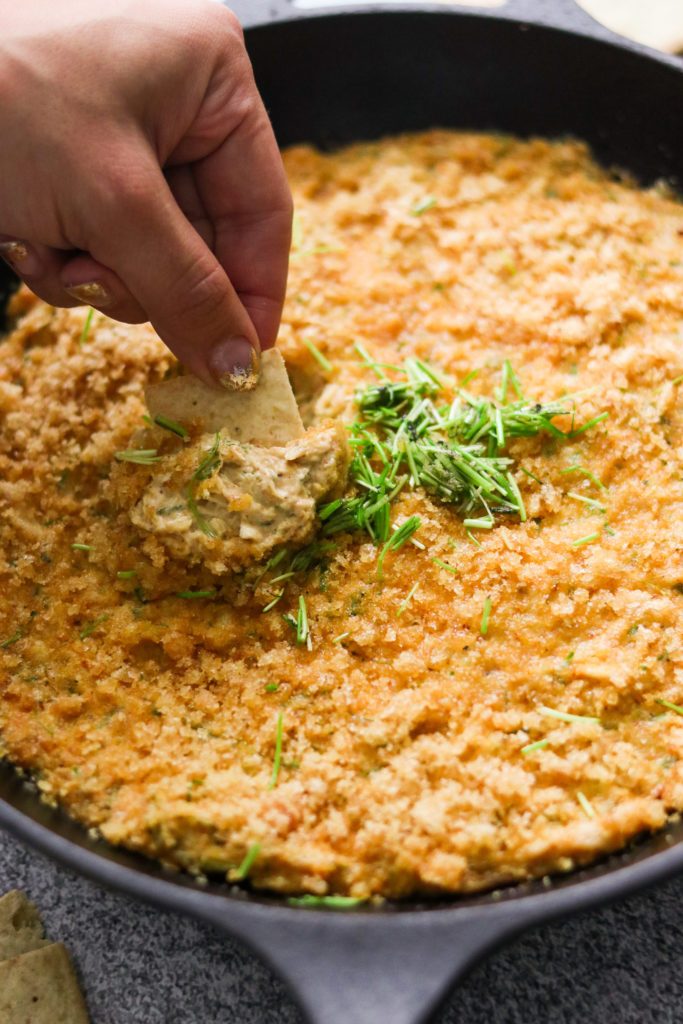 scooping keto crab dip recipe witha . cracker