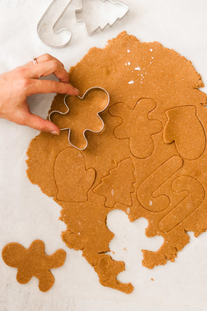 cutting out Paleo gingerbread cookies