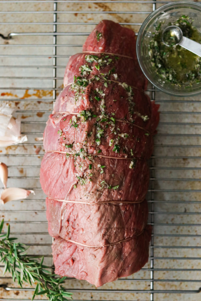 making rosemary and garlic crusted roast beef recipe