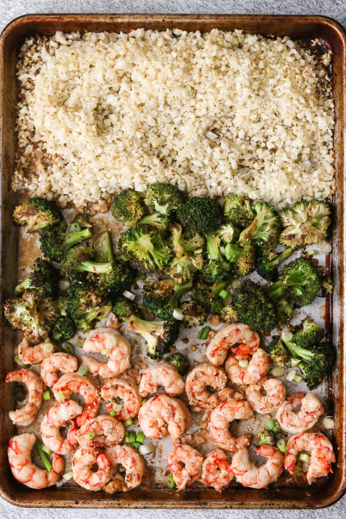 Overhead shot of Whole30 sheet pan meal: cauliflower rice, broccoli, and shrimp