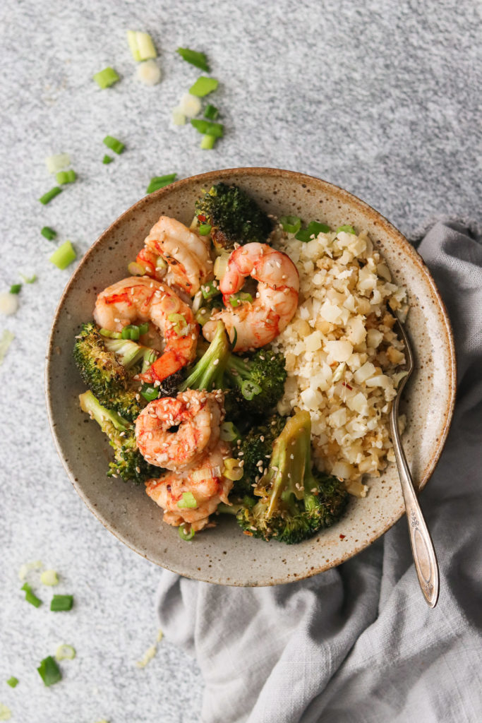 sheet pan shrimp and broccoli served in a bowl