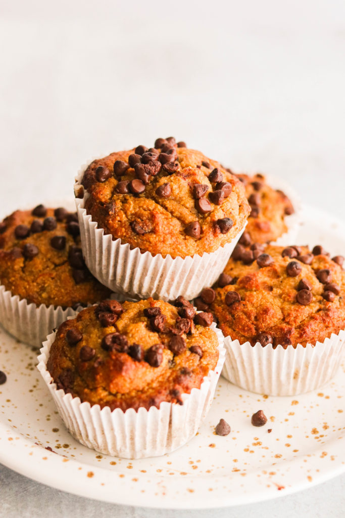 Paleo sweet potato muffins stacked on a plate
