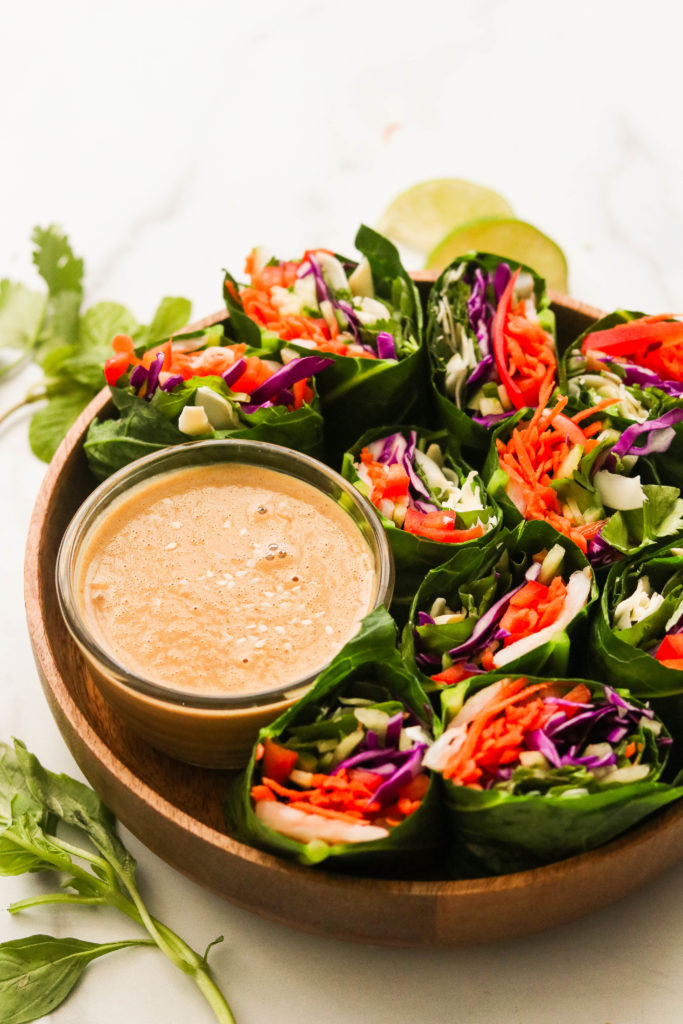 Whole30 collard wrap spring rolls in a wooden bowl