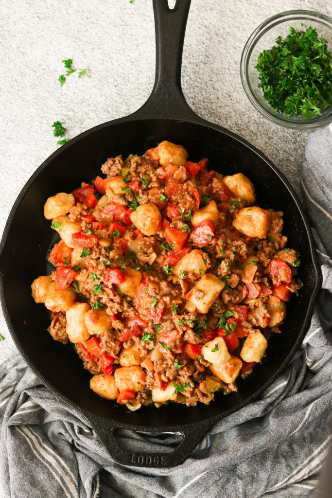 Air fryer cauliflower gnocchi coated in  paleo bolognese