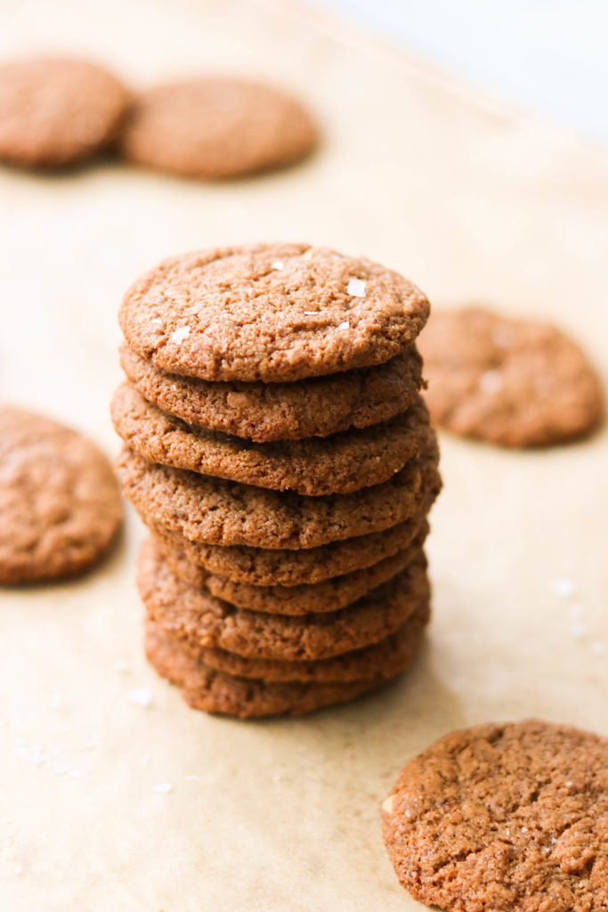 4-ingredient keto cookies stacked on a parchment paper
