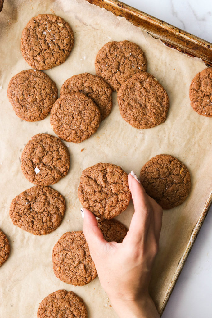 easy paleo cookies with hand reaching for a cookie