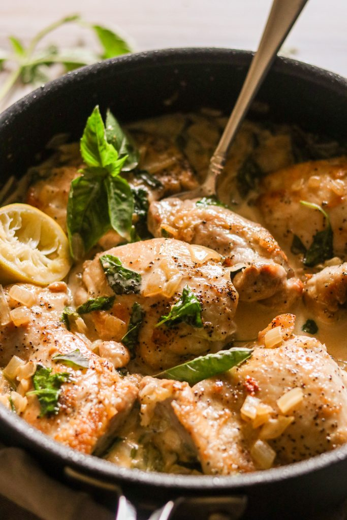 creamy chicken skillet - Lifting a chicken thigh with a spoon