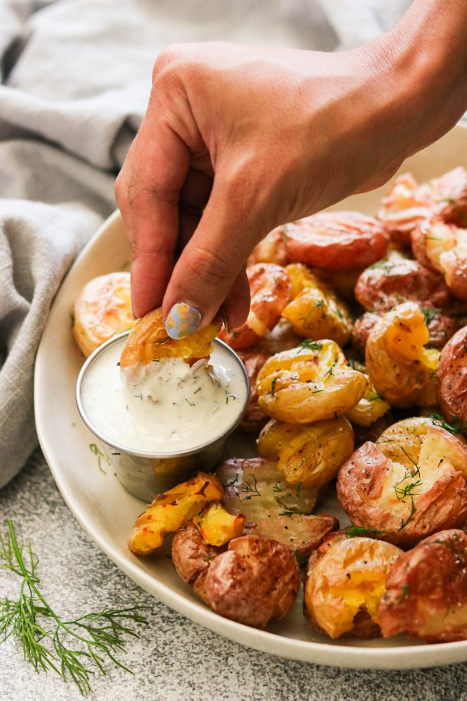 easy smashed potatoes recipe - crispy potato dipping in dill pickle aioli