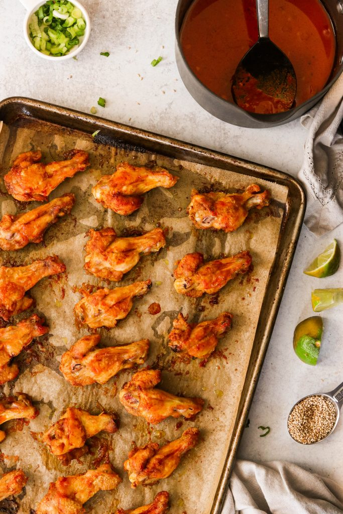 best oven baked wings arranged on a baking sheet