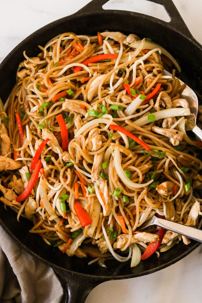 paleo lo mein cooked in a skillet with chicken and vegetables