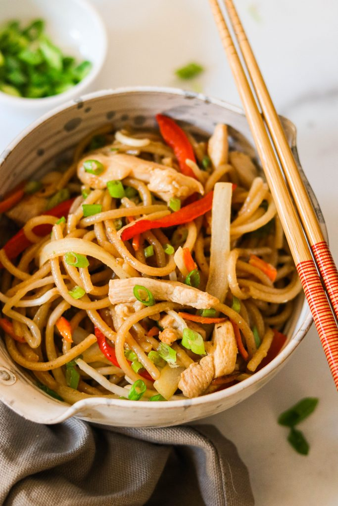 paleo chicken lo mein served in a bowl with chopsticks