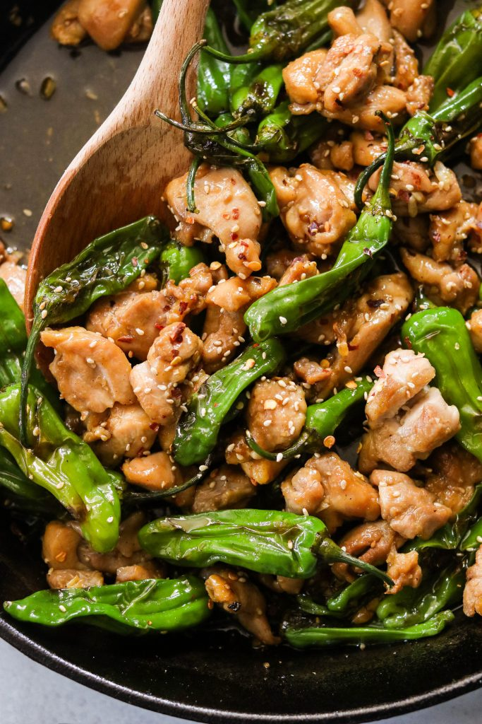 paleo mongolian chicken with shishito peppers stir fried in a skillet