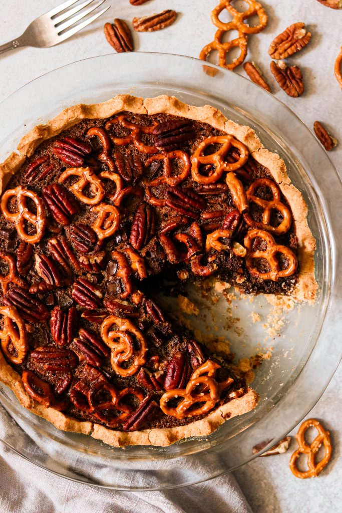 Gluten free chocolate pecan pie with a slice taken out