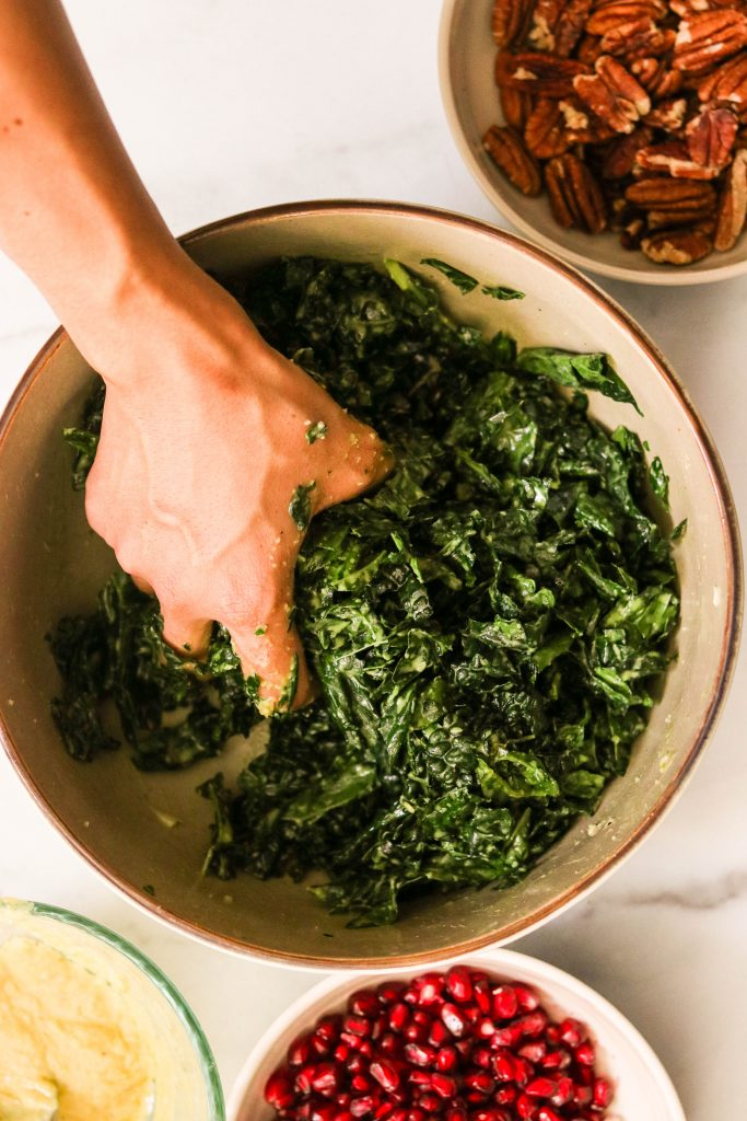 showing how to massage kale for salad with your hand