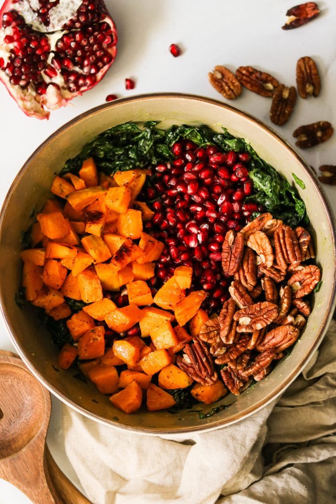 easy massaged kale salad with winter squash, pomegranate, and pecans