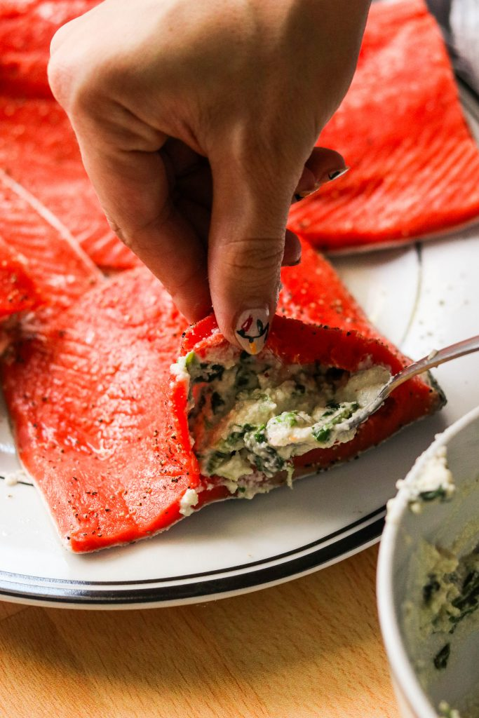 how to make stuffed salmon with spinach - using a spoon to stuff a salmon