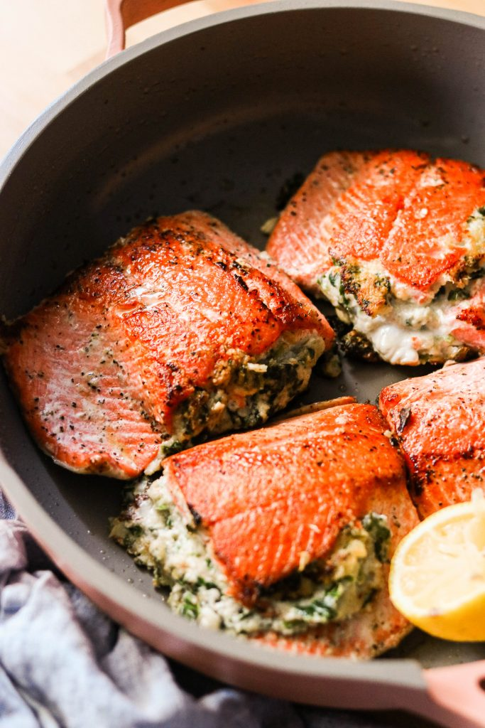 close up of creamed spinach stuffed salmon