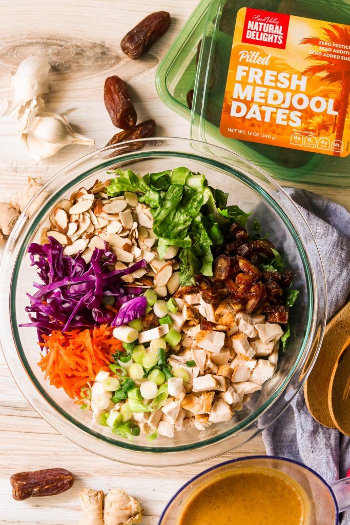 chinese chicken salad ingredients in a mixing bowl