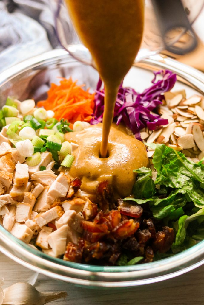 easy chinese chicken salad dressing recipe pouring over salad