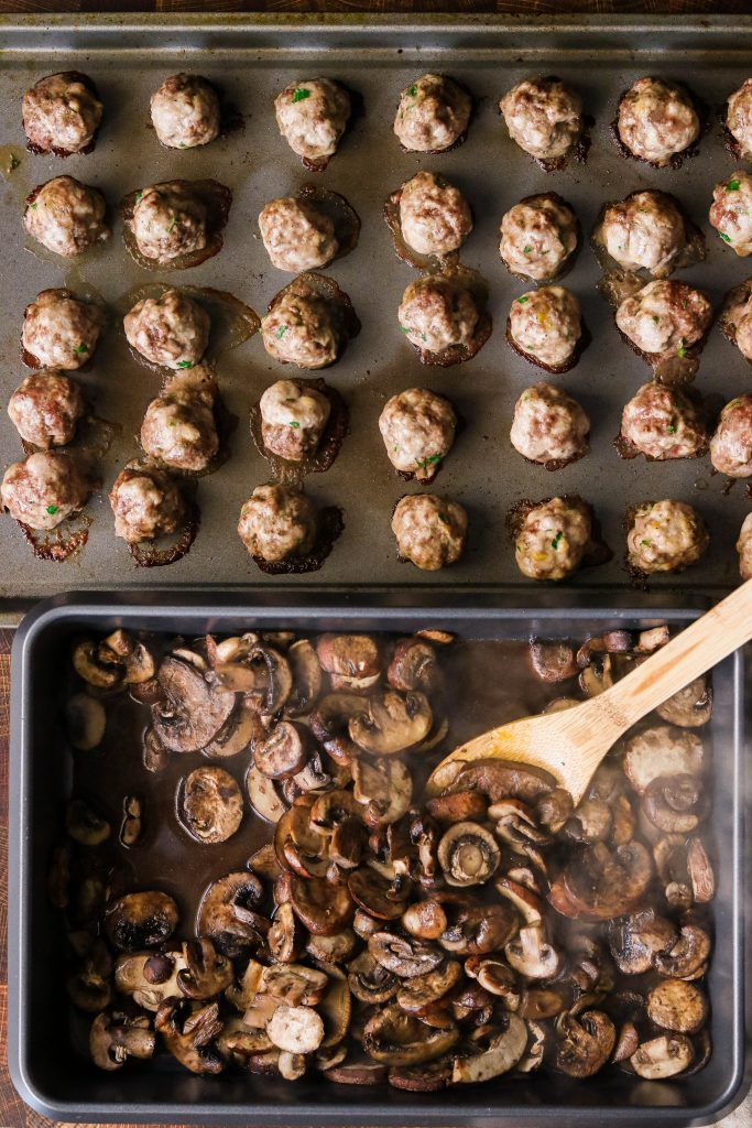 roasted meatballs and mushrooms in a sheet pan for mushroom meatball soup