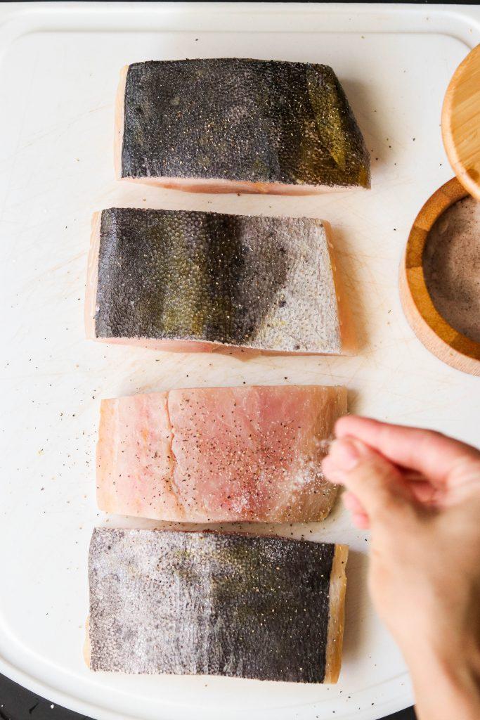 how to pan fry mahi mahi - sprinkling fliets with salt and pepper