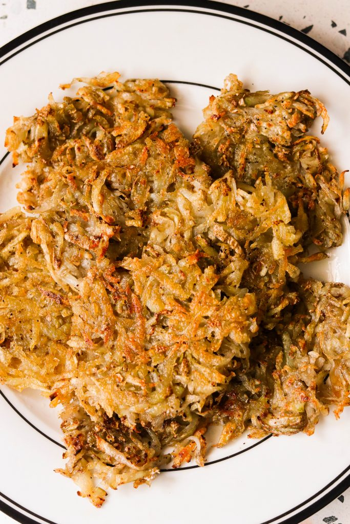 The Crispiest Whole30 Hash Browns on a plate