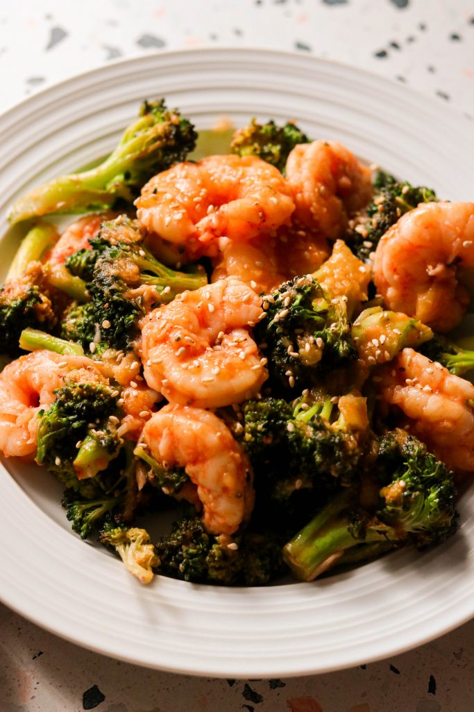 sweet and sour shrimp with broccoli on a plate