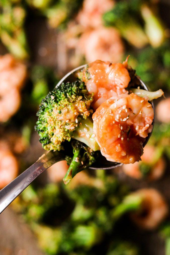 close up shot of shrimp and broccoli sheet pan dinner