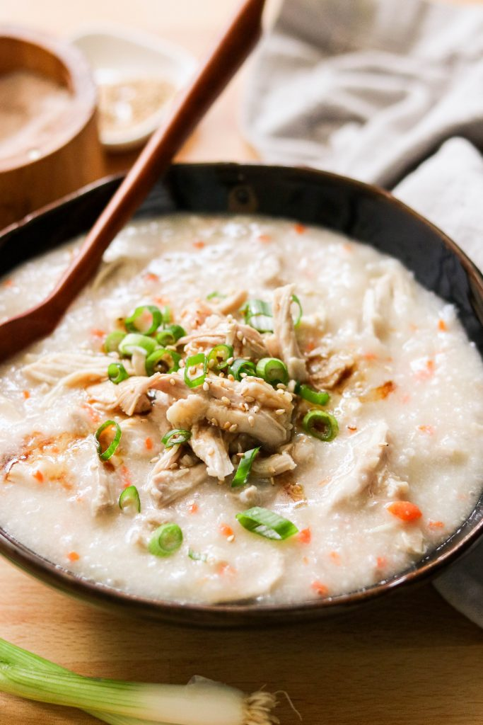 dak juk served in a bowl with a spoon