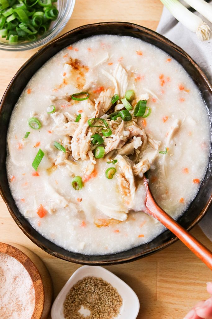 korean chicken rice porridge, garnished with green onions and sesame seeds