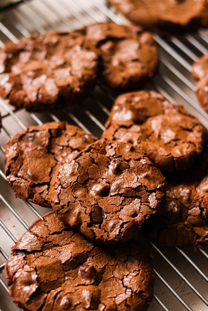 paleo flourless chocolate cookies piled on a cooling rack