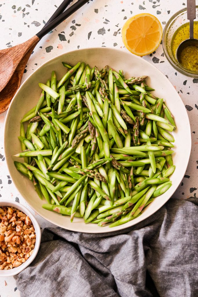 raw asparagus in a large bowl