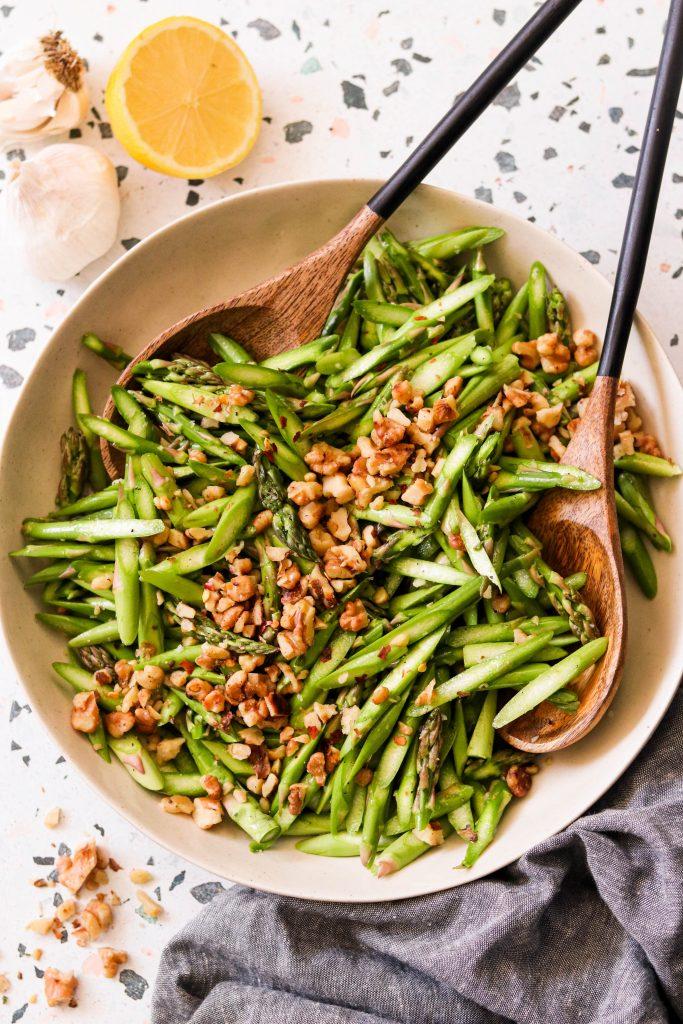 Adding walnuts into vegan asparagus salad