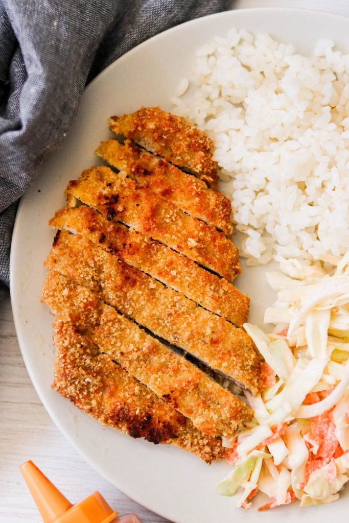 crunchy keto pork cutlets (air fryer tonkatsu) served with rice and coleslaw