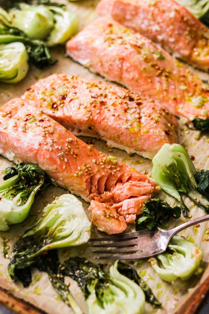close up of perfectly cooked salmon on whole30 sheet pan dinner