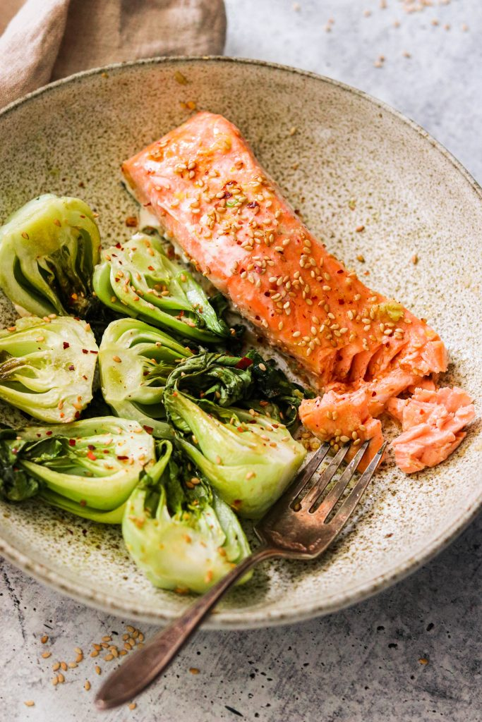 sheet pan salmon and bok choy served in a plate