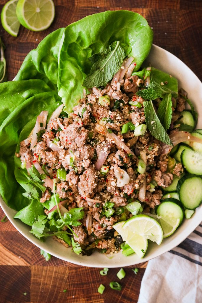paleo thai larb recipe served on plate with lettuce and cucumbers