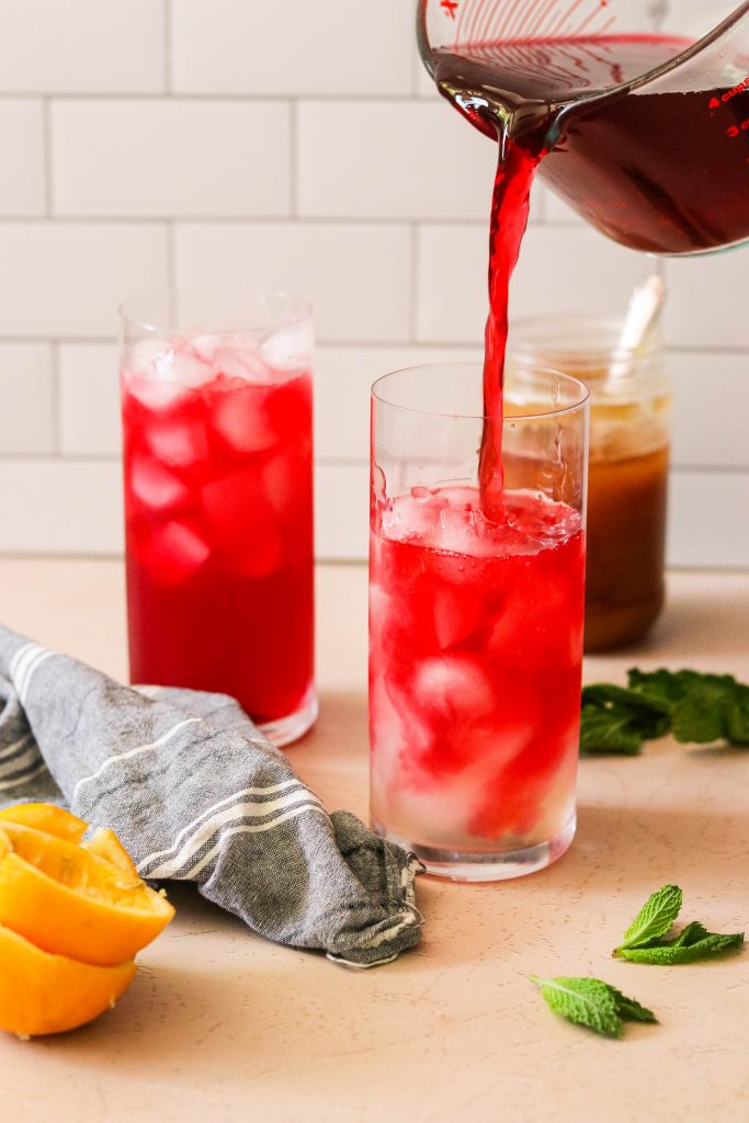 pouring paleo lemonade into glasses