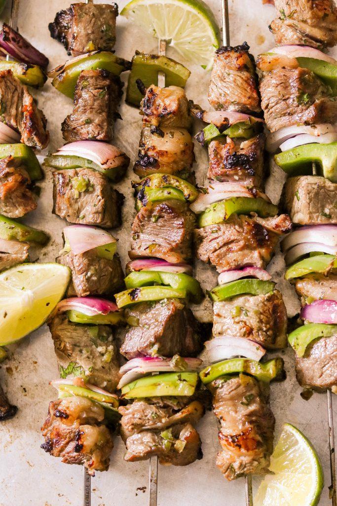carne asada steak kebabs with limes