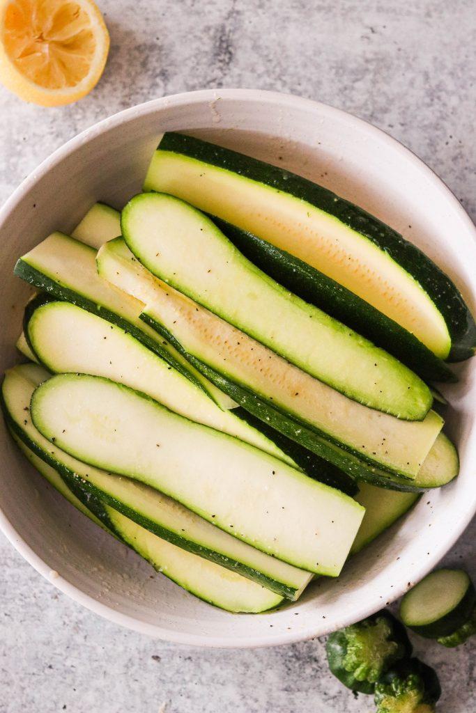 sliced raw zucchini coated in marinade