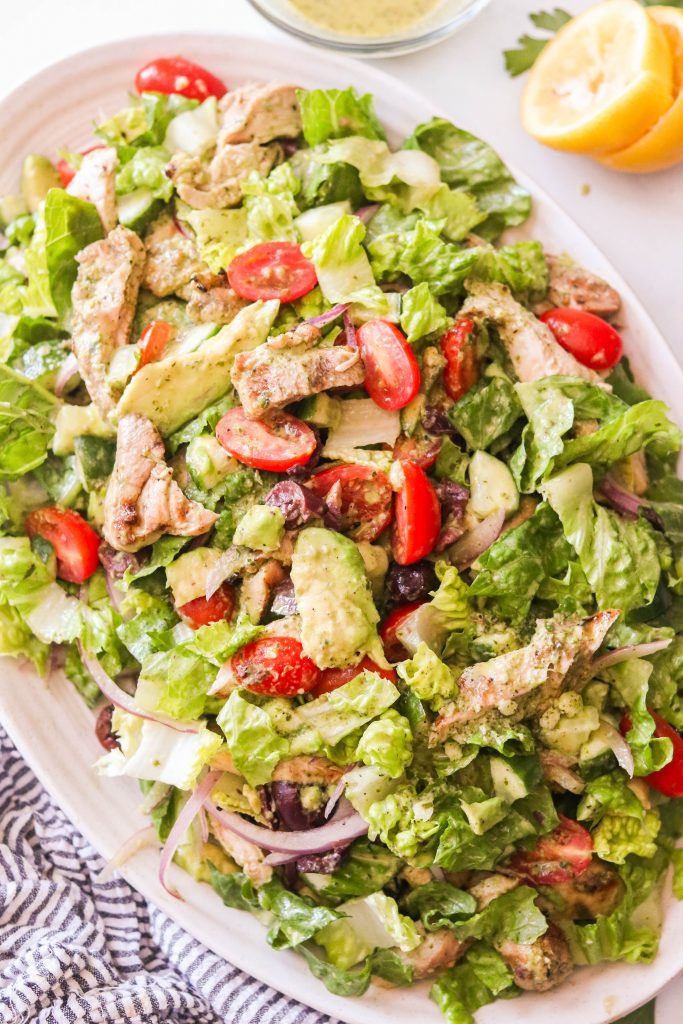 Whole30 Mediterranean Chicken Salad mixed with dressing on a plate