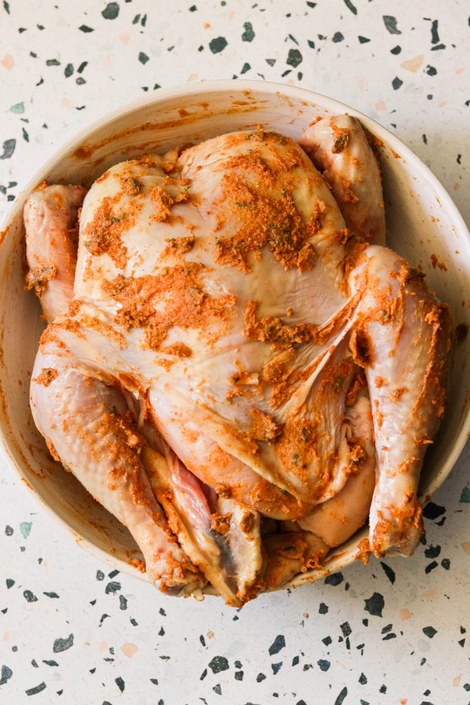 delicious rub on uncooked whole chicken