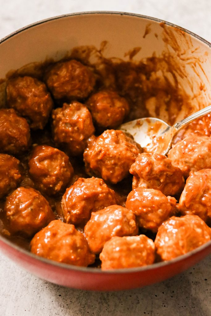 covering meatballs in sauce for asian chicken meatball recipe