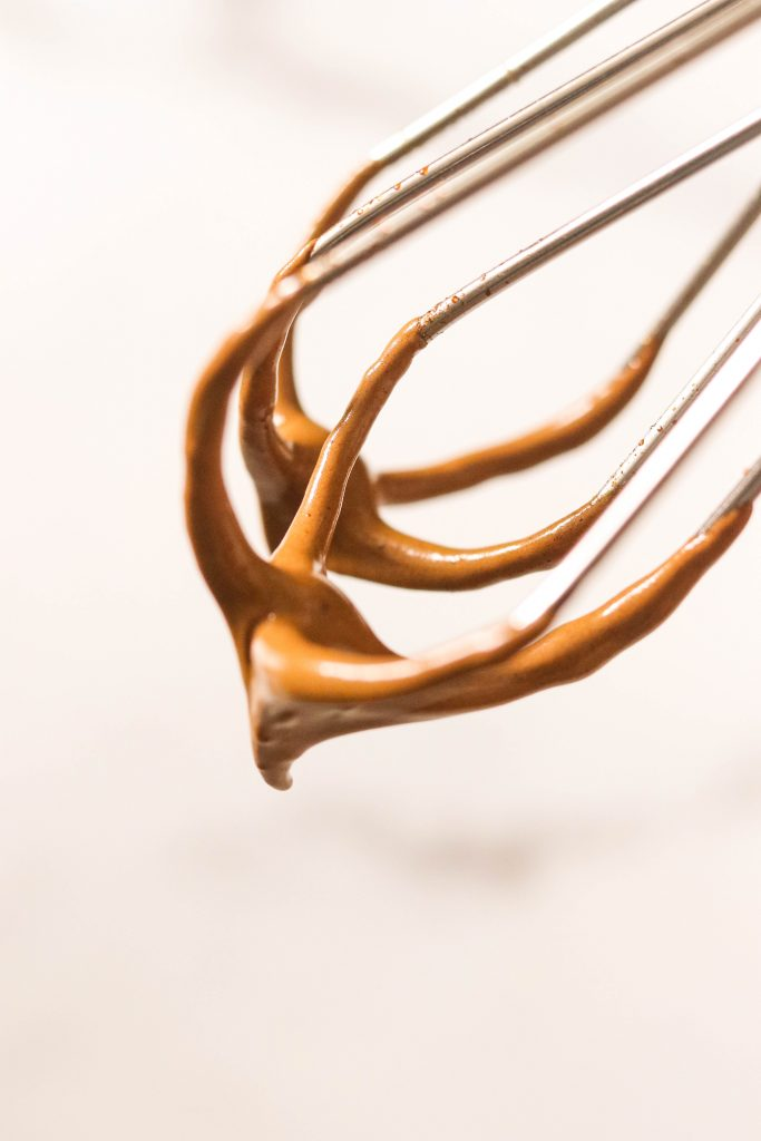 whipped coffee on a whisk with soft peaks