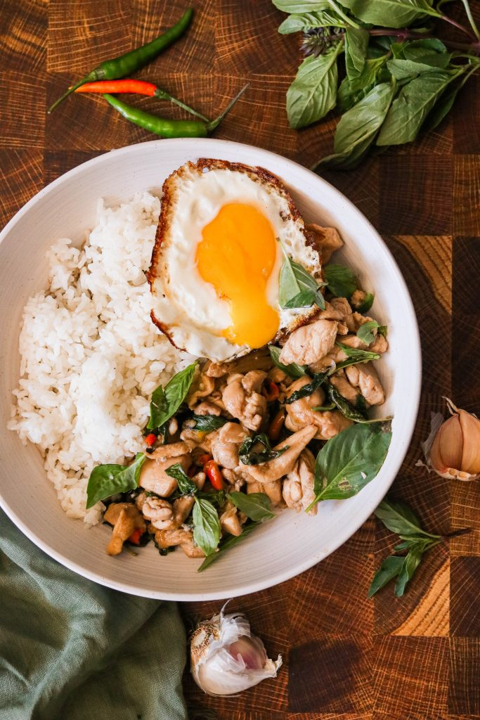 easy thai basil chicken recipe served with rice and a fried egg