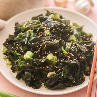 Asian seaweed salad served on a plate with chopsticks